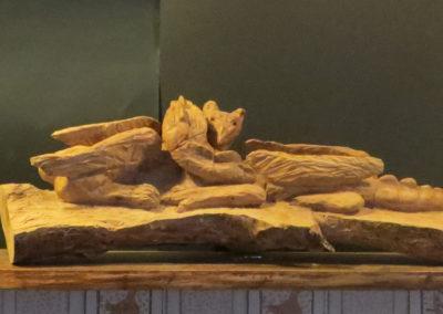 Lotta di mostri, scultura a tutto tondo, legno di pero 80x20x20